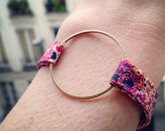 Fabric with clasp, with a thin circle of brass bracelet