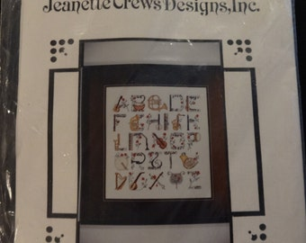 Cross-stitch kit - musical instrument alphabet
