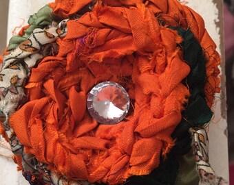 Pretty in orange flower pin crystal center julies bloomies