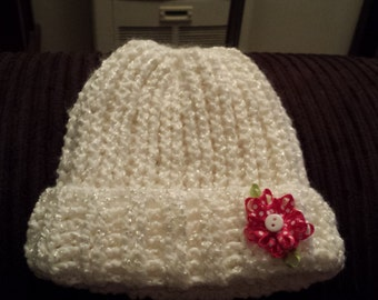 crochet hat with a pink flower