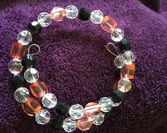 Orange,black, and clear beaded bracelet