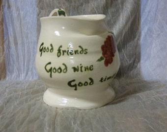 Handmade and painted pottery wine jug