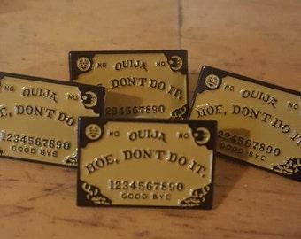 Hoe Don't Do It ouija board enamel pin