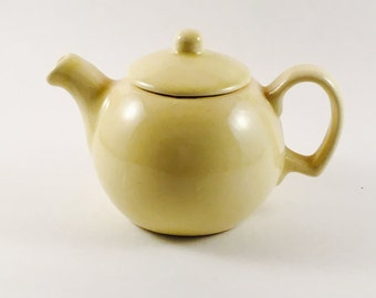 Vintage small yellow teapot unmarked