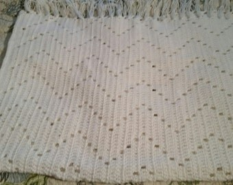White baby blanket with fringe, zig zag pattern