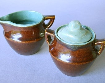 Pottery sugar bowl and creamer set
