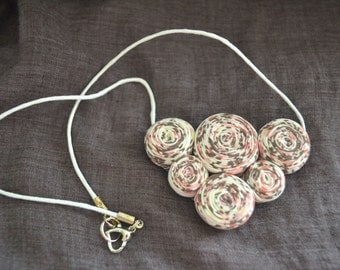 Textile bib necklace in beige and rose