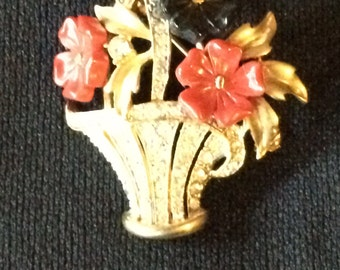 Unmarked molded glass and rhinestone flower basket brooch