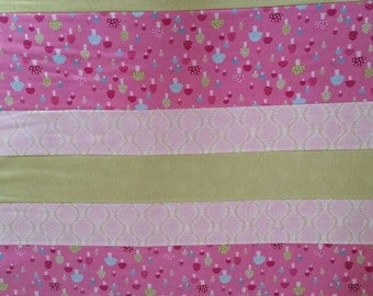 Quilted striped child's blanket