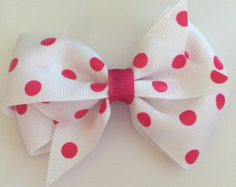 Pink and white poka dotted hair bow