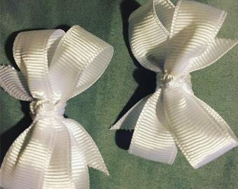 White pinwheel pigtails