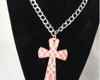 Peach and white cross pendant on a silver chain