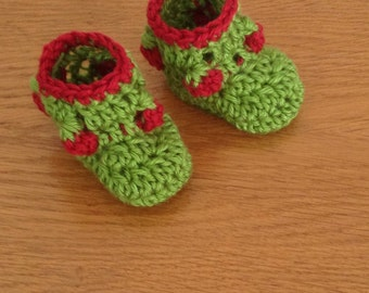 Crochet baby booties with strawberries