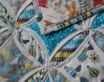 Handmade baby quilt in soft grey and blue