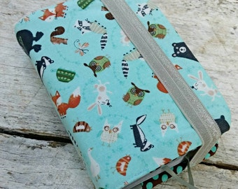 NWT reversible Bible cover, Cute woodland creatures blue background, pocket sized. Foxes, bears, owls, turtles, raccoons, rabbits, squirrels