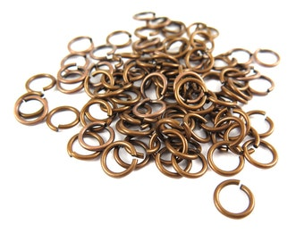 Antiqued Brass Round Jump Rings - 7mm - 12 grams (approx. 125x) (F627)