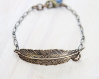 so i fly . a small feather bracelet