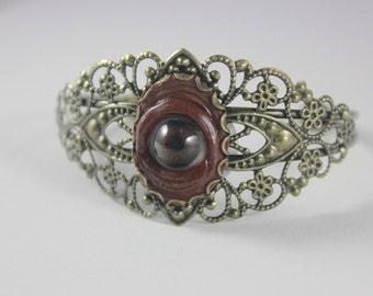 Small Brown Eye Brass Filigree bracelet