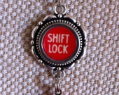 Rare red shift lock key necklace with red bead drop accent / silvertone flower pendant / typewriter key pendant