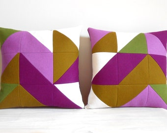 Two green, purple and white felt pillow covers. Geometric triangles. 30 x 30 cm patchwork pillow covers with buttons in the back.