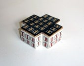 porcelain square cross box with underglaze and scrafitto pattern and gold luster