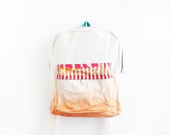 Orange dyed backpack with pink and orange pouch