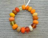 Frosty orange spacers - Lampwork beads by Loupiac