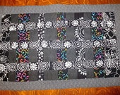 Black batik and calico quilted insulated table runner with a splash of color --- gorgeous unique two sided one of a kind ---great gift