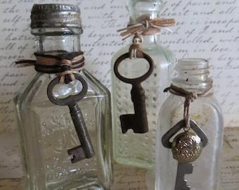 Antique Bottle Trio With Skeleton Keys