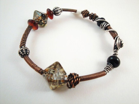 Funky bangle bracelet with mixed beads. On sale now.  Devine Designs Jewelry on Etsy