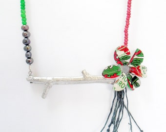 Twig flower necklace. Featuring reclaimed tins with pure tin.