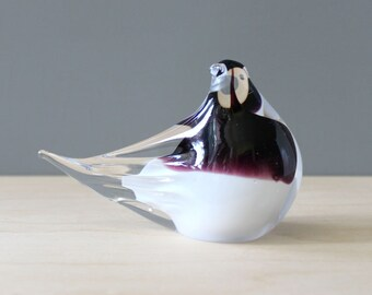 Purple and white glass bird figurine.