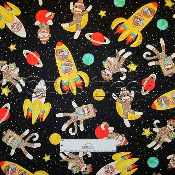 Sale yards sock monkeys in space black quilt fabric by the for Space fabric by the yard