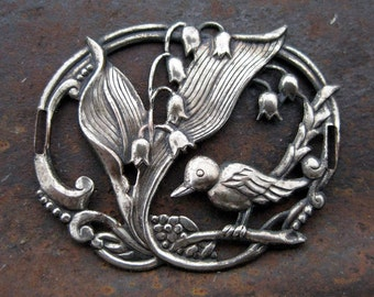 Vintage bird and flower metal stamping finding with patina metal embellishment