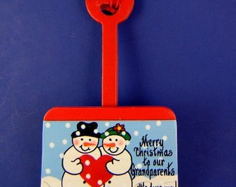 0042 Snowman couple shovel.  Free shipping. Message shown is a suggestion. Orns. can be written with a message/name/date of your choice.
