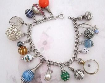 silver tone OOAK charm bracelet with vintage components - j6209