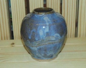 brown and blue vase with carving