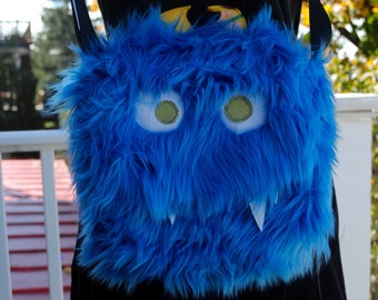 Medium Nomnom Monster Furry Messenger bag --Drongo