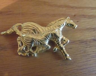 running zebras brooch