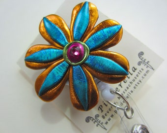 Whimsical flower Badge Reel in teal and copper alligator or belt clip