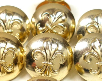 60s BUTTONS, 7 Victorian fleur-de-lys in gold, made in London.