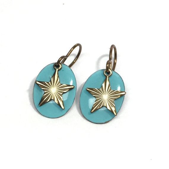 Turquoise oval earrings with brass star dangles