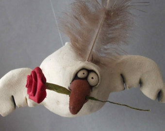 Flying Bird Ceramic Sculpture with Rose
