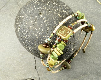Lazy days  a mellow adjustable wrap around bracelet made with genuine Maine sea stones and magnasite  stone funky organic jewelry