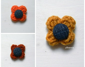 Flower lapel pin. Men's boutonniere. Buttonhole. Denim. Saffron, orange, burnt orange.
