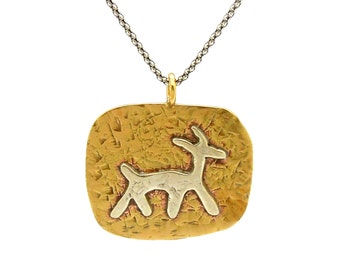 Brass pendant necklace with a silver animal figure