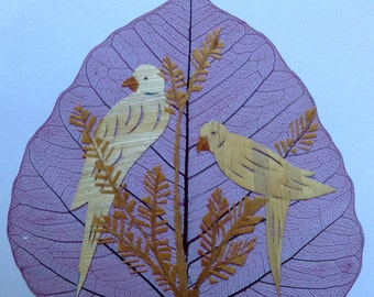 Parrots Handmade with rice straw (dried Leaves) of rice plant. Have U seen ancient lart.? Two leaves nor two of my handmade leaf art alike