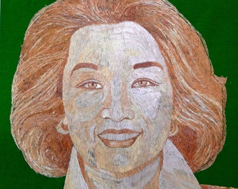Connie Chung CBS news anchor portrait mode of rice straw. Have U seen ancient rice straw art? Thousands of tiny pieces used to make it.