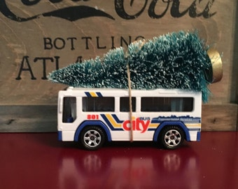 City Bus Carrying Christmas Tree Ornament