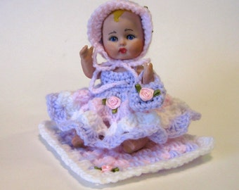 "Doll 5"" full porcelain little girl cast from a vintage mold and dressed in a crocheted outfit"